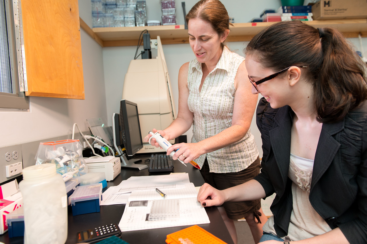 Erin McMullin and student in lab setting