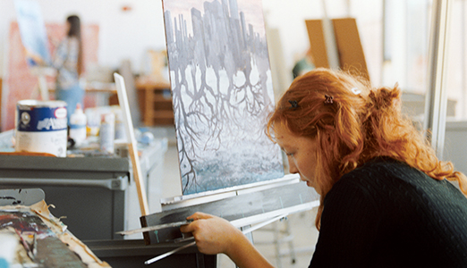Student working in a painting studio.