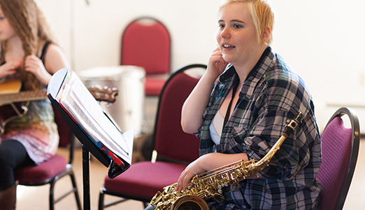 A female students attends jazz ensemble practice.