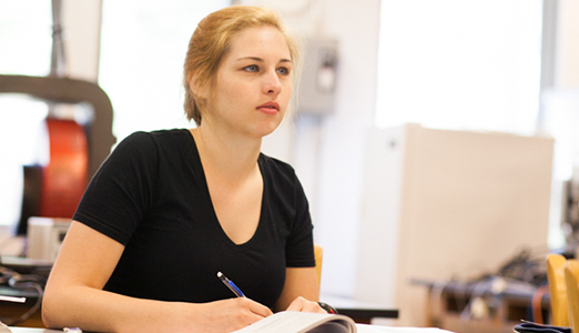 A female student listens attentively during class.