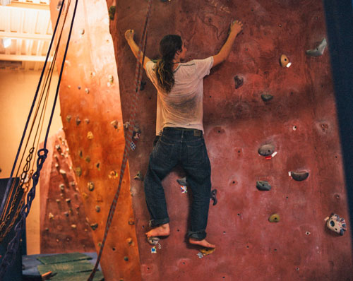 Academy student on the climbing wall in the KAC