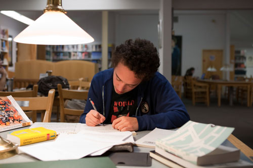 Academy student studying in the library