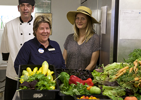 Dining hall staff with fresh produce