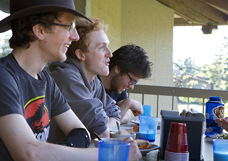 Students eating on dining hall balcony
