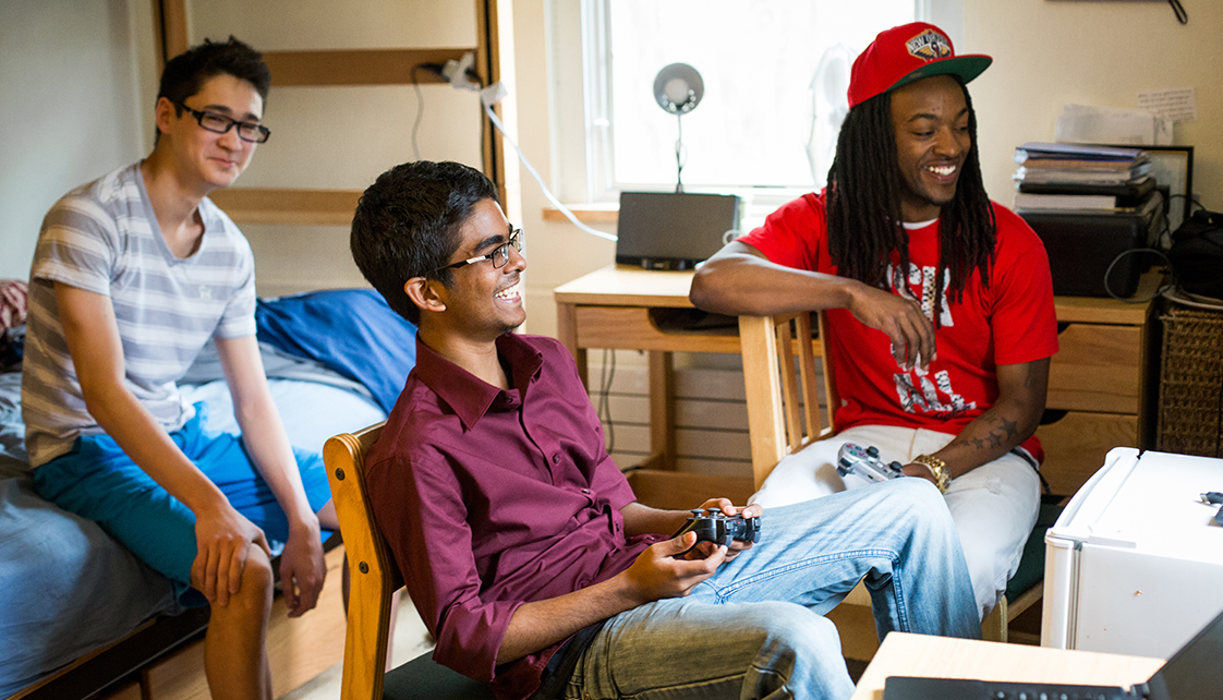 Students playing games in dorm room