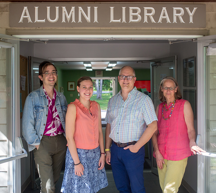 The Alumni Library staff at the library entrance.