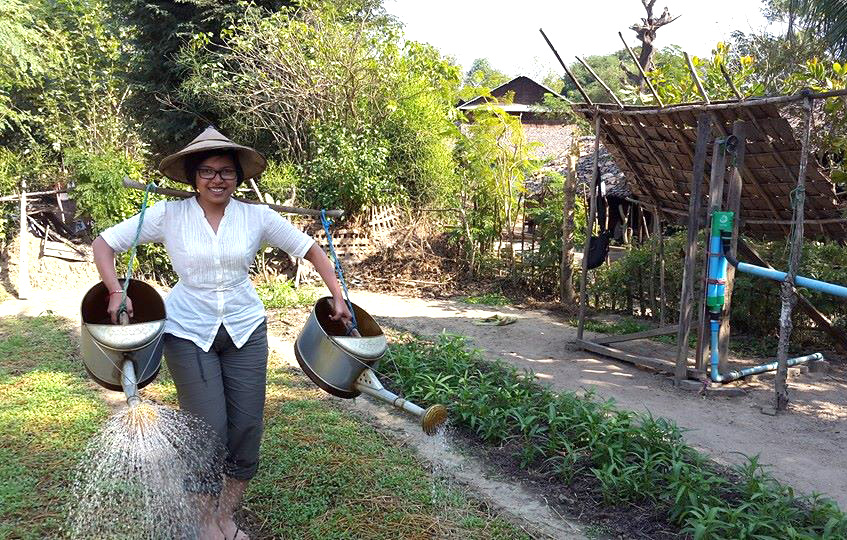 Phyu Hninn Nyein with watering can