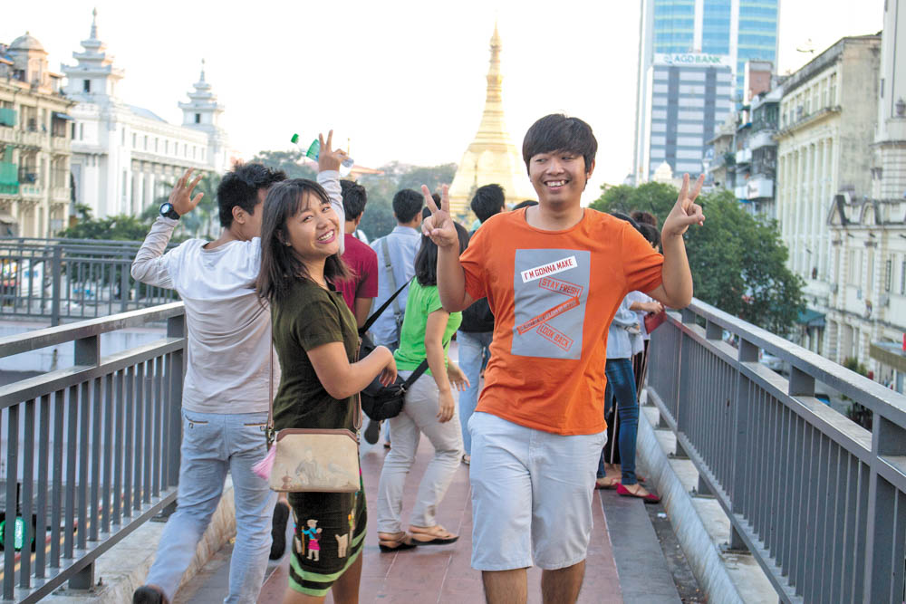 Students pose in front of Yangon's Sule Pagoda