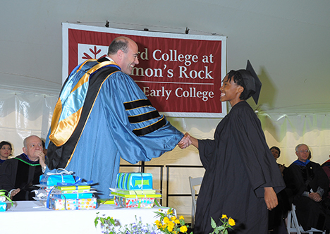 Provost Laipson shaking hands with female graduate