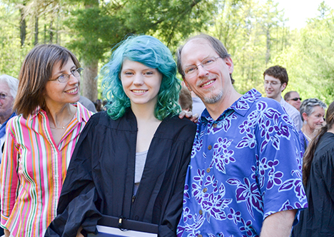 Student with parents at graduation